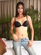 Justine is so hot and exciting in her black bra and tight jeans.